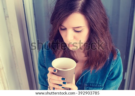 Closeup portrait unhappy sad depressed young woman sitting outdoors. Negative human emotion facial expression - stock photo