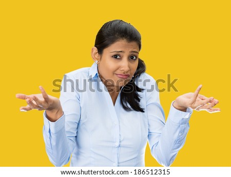 Closeup portrait, unhappy, young, pretty business woman, manager, student, worker asking whats the problem, who cares, so what, I dont know. Isolated yellow background. Negative human emotions - stock photo