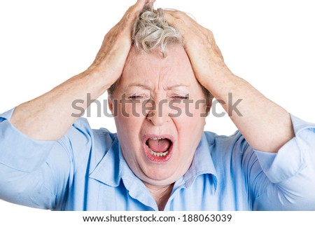 Closeup portrait, upset, frustrated, overwhelmed, senior mature woman squeezing head, going nuts, screaming, losing mind, isolated, white background. Negative emotion facial expression feelings - stock photo