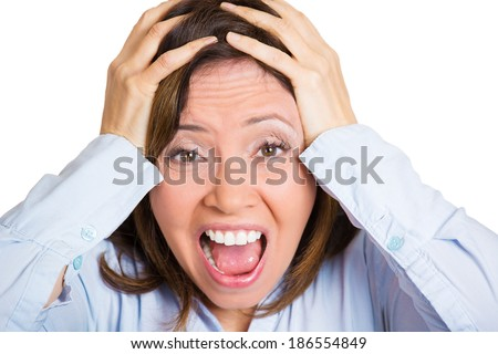 Closeup portrait, upset, frustrated, overwhelmed, stressed mature woman squeezing head, going nuts, screaming, losing mind, isolated, white background. Negative human emotion facial expression feeling - stock photo