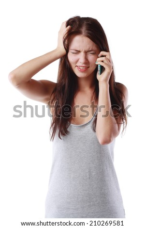 Closeup portrait, upset, sad, depressed, unhappy worried young woman talking on the phone, isolated white background. Negative human emotions, facial expressions, feelings, reaction. Bad news.  - stock photo