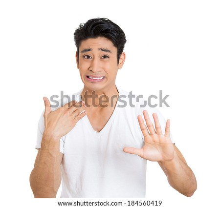 Closeup portrait, worried young man gesturing with hand to stop talking, cut it out, dont go there, isolated white background. Negative emotion facial expression feelings, signs symbols, body language - stock photo