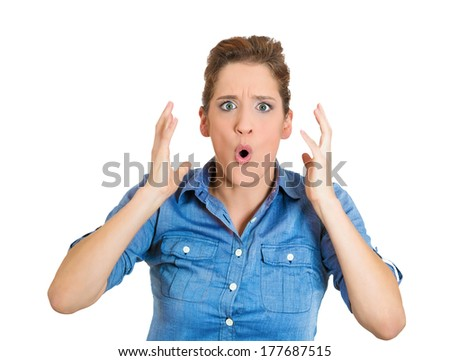 Closeup portrait, worried young pretty woman looking shocked surprised in full disbelief hands in air opened mouth eyes, isolated on white background. Positive human emotion facial expression feeling - stock photo