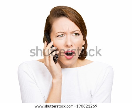 Closeup portrait young angry business woman, corporate employee talking on cell phone, having unpleasant, bad conversation, isolated white background. Negative emotions, facial expressions, reaction - stock photo