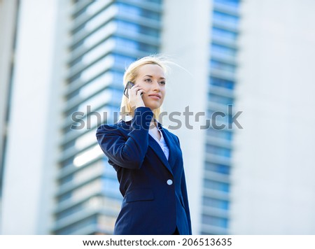 Closeup portrait young attractive happy successful businesswoman, entrepreneur, corporate employee talking on cellphone while walking on street, isolated outdoors background office, company building - stock photo