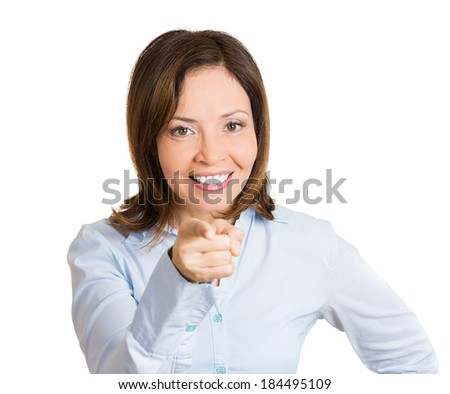 Closeup portrait, young, beautiful, excited, happy woman smiling, pointing finger towards you, camera gesture, isolated white background. Positive human emotion, attitude, reaction