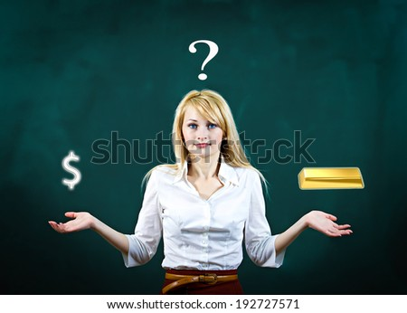 Closeup portrait young blonde, confused, puzzled business woman uncertain what safer investment decision to make, gold versus cash, dollars isolated green background. Financial opportunities, banking  - stock photo