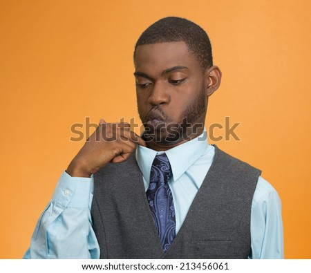 Closeup portrait, young business man opening shirt to vent, it's hot, unpleasant, awkward Situation, Embarrassment. Isolated orange background. Negative Emotion Face Expression, Feeling body language - stock photo