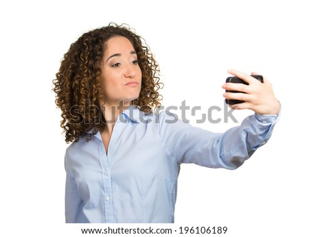 Closeup portrait young cocky beautiful woman, lady, checking, looking admiring her face, hair in front pocket mirror, isolated white background. Human emotion facial expression feeling life perception - stock photo