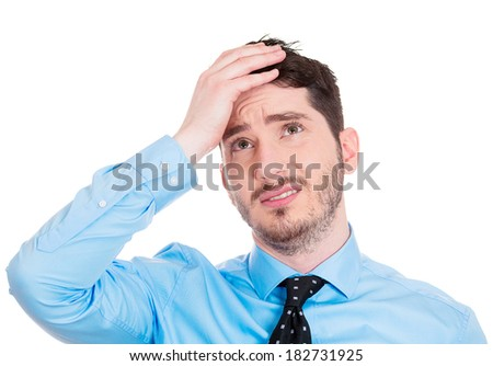 Closeup portrait young confused sad business man, troubled, deep thought, isolated white background. Negative human emotions, facial expressions, life perception, reaction, attitude - stock photo