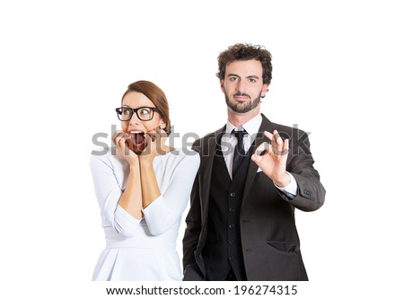 Closeup portrait young couple man, woman. Guy being excited happy, smiling giving ok sign, girl concerned, anxious scared, freaking out biting finger nails, isolated white background. Emotion contrast - stock photo