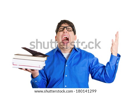 Closeup portrait young funny looking guy upset screaming man with glasses holding books, empty wallet on top, anxious completely broke no money left after tuition was paid isolated on white background - stock photo
