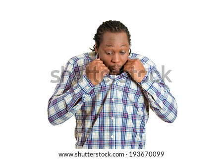 Closeup portrait, young funny looking man opening shirt to vent, blow air, it's hot, unpleasant awkward situation, embarrassment. Isolated white background. Negative emotion, facial expression feeling - stock photo