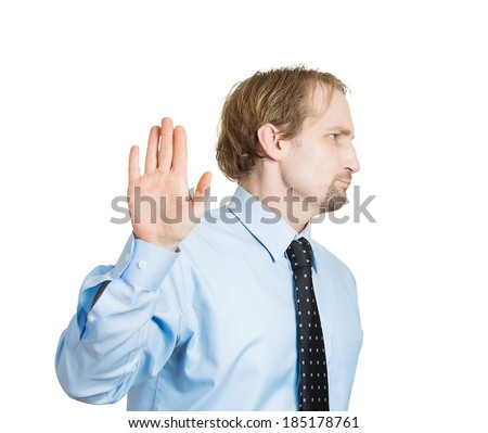 Closeup portrait, young handsome, grumpy man with bad attitude giving talk to hand gesture with palm outward, isolated white background. Negative emotions, facial expression feelings, body language - stock photo