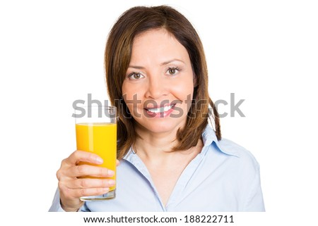 Closeup portrait young, happy, beautiful, smiling, healthy female holding glass orange juice isolated white background. Nutrition, organic diet weight loss program. Positive facial expression, emotion - stock photo