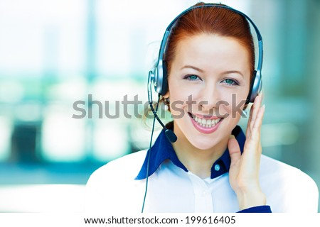Closeup portrait young happy successful business woman, customer service representative, call centre worker, operator, support staff speaking with head set isolated background corporate office windows - stock photo