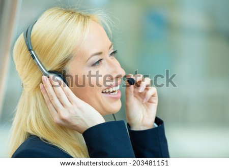 Closeup portrait young happy successful business woman, customer service representative, call centre worker, operator, support staff speaking with head set - stock photo