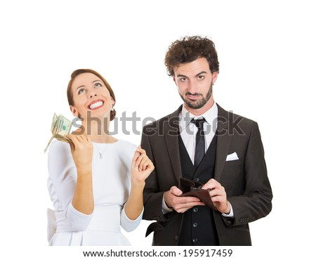 Closeup portrait young happy woman got money dollar bills cash from skeptical, dubious, upset man holding empty wallet isolated white background. Human emotion facial expression body language reaction - stock photo