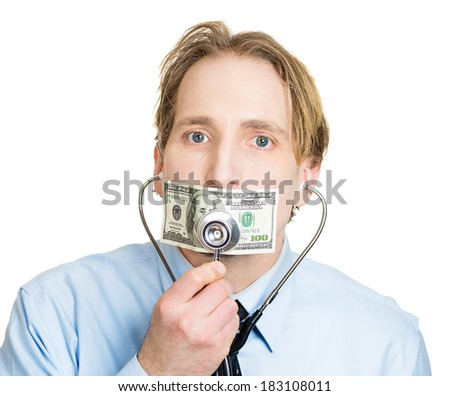 Closeup portrait, young healthcare professional placing stethoscope to hundred dollar bill taped to mouth, isolated white background. Big pharmaceutical company bribes, health care costs and expenses - stock photo