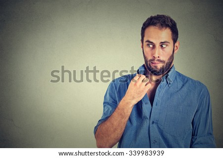 Closeup portrait, young man opening shirt to vent, it's hot, unpleasant, Awkward Situation, Embarrassment. Isolated on gray background. Negative emotions facial expression, feelings - stock photo