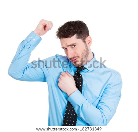 Closeup portrait young man, sniffing his wet armpit, something stinks, bad, foul odor situation, isolated white background. Is it me? Negative human emotions, facial expressions, feeling reaction - stock photo