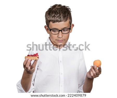 Closeup portrait young man with glasses deciding on diet, making choice sweet cookie tart fresh fruit apricot isolated white background. Weight control eating habits. Confused face expression, emotion - stock photo