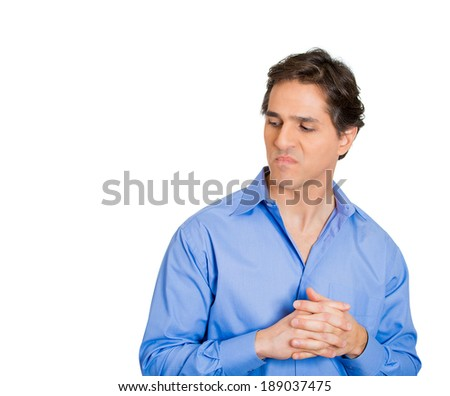 Closeup portrait, young man with hands clasped to chest, looking to side, very annoyed and jealous of someone, isolated white background. Negative human emotion facial expression feelings. - stock photo