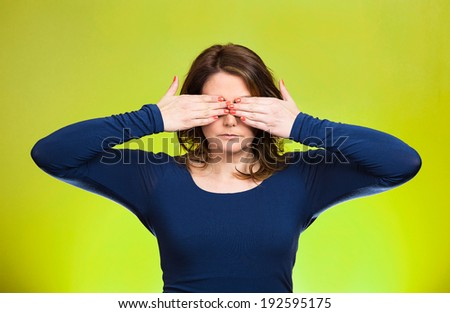 Closeup portrait young middle aged woman, closing, covering eyes with hands can't look, hiding, avoiding situation, isolated green background. See no evil concept. Human emotions, facial expressions - stock photo