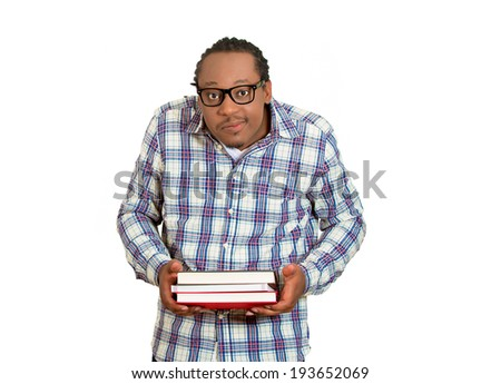 Closeup portrait young nerdy, funny looking man with glasses,  timid, shy, anxious, nervous, student holding books isolated white background. Human emotions, facial expressions, feelings, reaction - stock photo