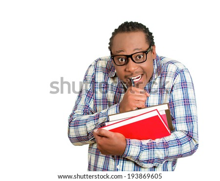 Closeup portrait young nerdy, funny looking man with glasses, timid, shy, anxious, nervous, student holding books writing something isolated white background. Human emotion, facial expression, feeling - stock photo