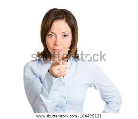 Closeup portrait, young pretty unhappy, serious woman pointing at someone as if to say you did something wrong, bad mistake isolated white background. Negative emotion, facial expression feeling - stock photo