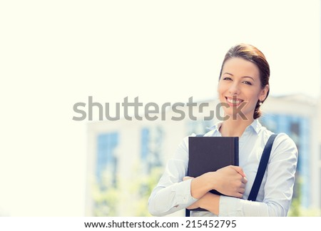 Closeup portrait, young professional, beautiful confident businesswoman in blue shirt, smiling isolated outdoor trees, city background. Positive human emotions, facial expressions, life perception - stock photo