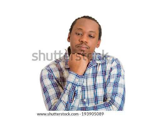 Closeup portrait young sad, serious man thinking, daydreaming deeply something bad, chin on hand, eyes looking down, isolated white background. Negative emotions, facial expression, feeling perception - stock photo