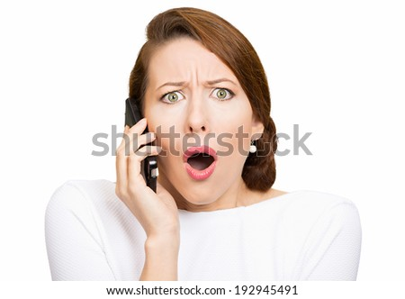 Closeup portrait young shocked business woman, corporate employee talking on cell phone, having unpleasant, bad conversation, isolated white background. Negative emotions, facial expressions, reaction - stock photo
