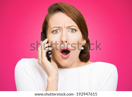 Closeup portrait young shocked business woman, corporate employee talking on cell phone, having unpleasant, bad conversation, isolated pink background. Negative emotion, facial expressions, reaction - stock photo