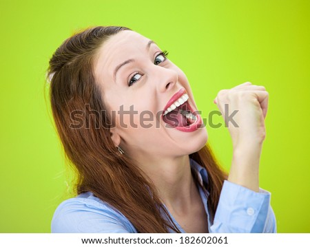 Closeup portrait young silly goofy woman gesturing with hand thumb to go party get drunk, hammered, wasted, tipsy isolated green background. Positive emotion, facial expression, feeling, sign, symbol. - stock photo