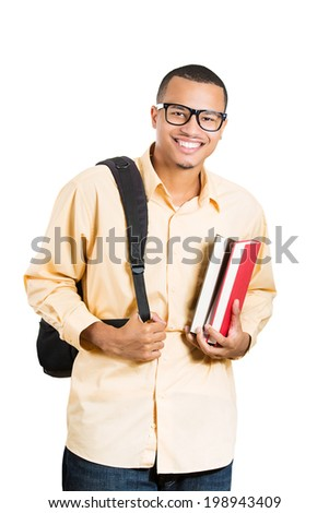Closeup portrait young smart handsome man, with glasses, holding books, bag over shoulder prepared, ready to take his test finals, isolated white background. Positive facial expression feeling emotion - stock photo