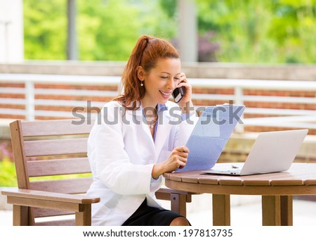 Closeup portrait, young smiling confident female doctor, healthcare professional talking on phone, giving consultation isolated background hospital park. Patient visit health care. Positive emotions - stock photo