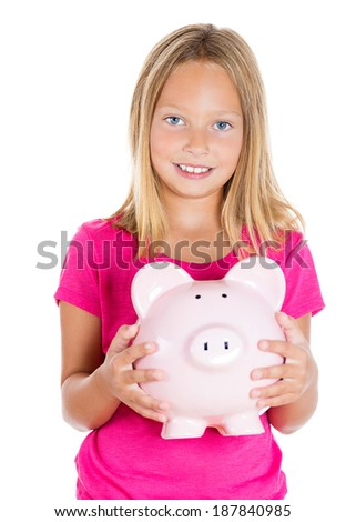 Closeup portrait, young smiling girl holding, hugging piggy bank filled with money, isolated white background. Smart currency financial investment wealth decisions. Budget management and savings - stock photo