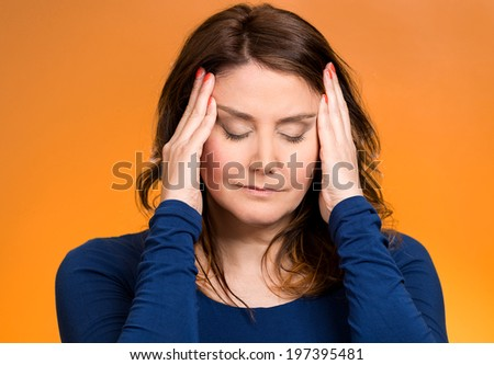 Closeup portrait young, stressed woman having so many thoughts, worried about future, thinking, isolated orange background. Human facial expressions, feelings, emotions, attitude, life perception - stock photo