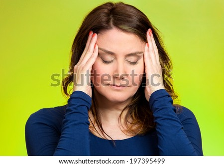 Closeup portrait young, stressed woman having so many thoughts, worried about future, thinking, isolated green background. Human facial expressions, feelings, emotions, attitude, life perception - stock photo