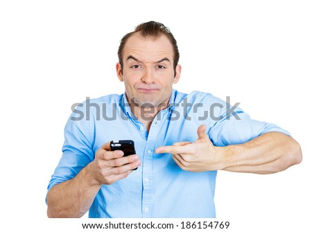 Closeup portrait, young, surprised, stunned, shocked, pissed man who is not happy by what he sees on his cellular phone, isolated white background. Negative human emotion facial expression feelings