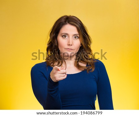 Closeup portrait young, unhappy, serious woman pointing at someone, blaming for something wrong, mistake, isolated yellow background. Negative human emotions, facial expressions, feelings, reaction - stock photo