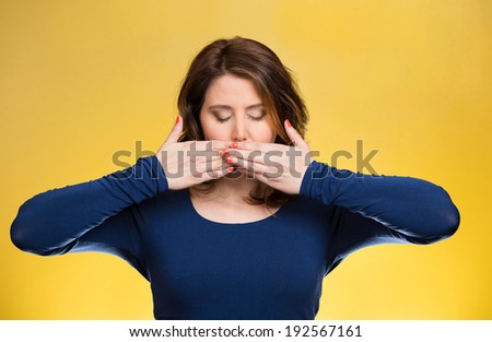 Closeup portrait young woman covering closed mouth, eyes. Speak, see no evil concept, isolated yellow background. Negative human emotions, facial expressions, signs, symbols. Media news coverup - stock photo