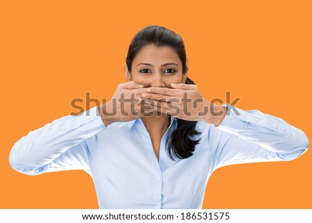 Closeup portrait, young woman covering closed mouth, open eyes. Speak no evil concept, isolated orange background. Negative human emotion facial expressions signs and symbols. Media news coverup - stock photo