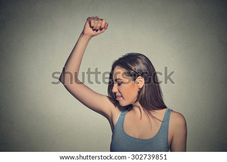 Closeup portrait young woman, smelling, sniffing her wet armpit, something stinks, very bad foul odor situation isolated grey wall background. Negative human emotion facial expression feeling reaction - stock photo