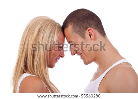 Closeup profile image of happy young couple looking face to face at eachother - stock photo