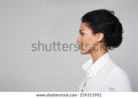 Closeup profile of confident business woman looking forward isolated on gray background - stock photo
