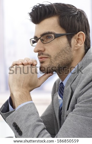 Closeup profile of thinking businessman in glasses. - stock photo