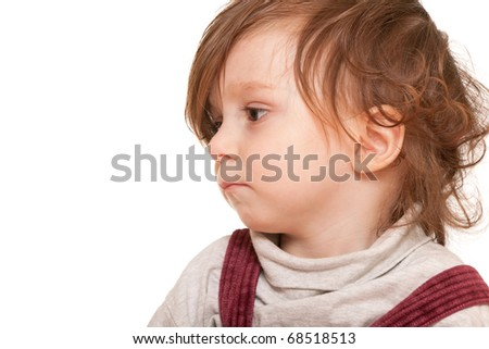 Closeup profile portrait of a sad curly toddler isolated on the white background - stock photo